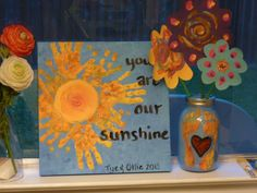 For Grandma on Mother's Day.  Hand Sun Painting and Foot Vase Mason Jar with Finger Painted Flowers.  Made with help from my sons ages 1 and 3 (great toddler project).