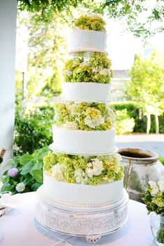 like the idea of dividing the tiers with flowers in-between just not as large