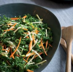 Rubbing the raw kale for this healthy salad with vinegar, olive oil and salt makes the leaves tender and sweet.