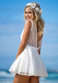 Sweet and sexy dress featuring plunge v back and structured skater skirt with floral lace shell and mesh hemline inside. Zip closure at back...