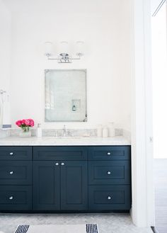 """Marble herringbone floors and Benjamin Moore """"Hale Navy"""" cabinets in Modern Bathroom Design // Love the Chrome Fixtures and Marble Counters Navy Bathroom, Bathroom Spa, Bathroom Renos, Washroom, Master Bathroom, Navy Blue Bathrooms, Houzz Bathroom, Marble Bathroom Floor, Lowes Bathroom"""