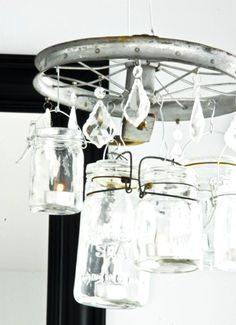 interesting chandelier made from mason jars, an old pulley, and some crystals, might be easy to replicate