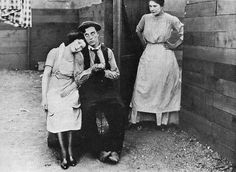 Buster Keaton, his feet, and some other people.