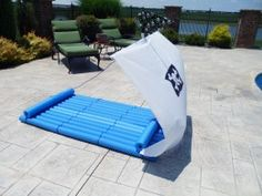 Making a pirate boat for the pool out of pool noodles is a fantastic idea for a pirate-themed pool party! -SvH
