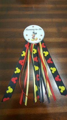 Check out this item in my Etsy shop https://www.etsy.com/listing/455791578/mickey-mouse-mommy-to-be-pin-baby-shower