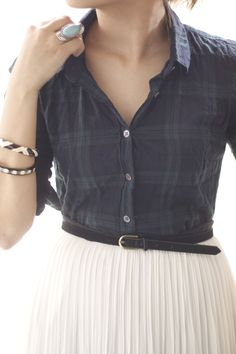 Plaid and flannel are popular this year. Loving this blackwatch plaid button-down with a knife-pleat chiffon skirt.