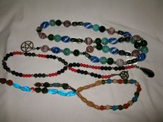 In many magical traditions and religious paths, the use of beads can be a meditative and magical exercise. Why not assemble a set of beads that holds meaning to you, and use it in your ritual practice and workings?