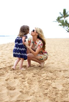 Emily Jackson of Ivory Lane and her daughter on a beach