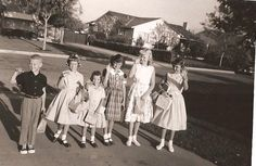 Off for the first day back to school - with lunches packed in sacks or metal lunch boxes - fall 1958 in So. Calif
