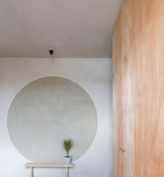 Layers of clay line the walls of this apartment, which has been overhauled by Simon Astridge to include a bathing area with smoked-oak panels