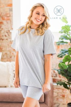 We are huge fans of our Jara Biker Short Set, and you will be too! With the oversized fit, high neck, and longer length of the top paired with the fitted biker shorts that fall to mid-thigh, what's not to love? Our set is easy to move around in and perfect for working out or lounging around the house! Heather Grey, Biker, Thighs, Tunic Tops, Sleeves, Model, Cotton, How To Wear, Fashion
