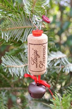 This ornament is one whole cork with a rustic jingle bell on a red ribbon.  I used red buttons on the top with a spare part from a Dollar Store ornament I took apart.