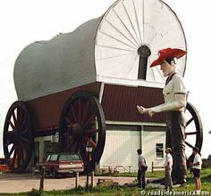 Sometimes the scale of the Plains dwarfs even a Muffler Man. This one stands next to the World's Largest Covered Wagon, Milford, Nebraska.