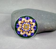 Yellow Daisy & Pansy Magnet Sacred Geometry Mandala Kaleidoscope Sunny Splendor <br /> <br />Yellow Daisy & Pansy sacred geometry mandala kaleidoscope glass bead magnet. Magnet is 50mm (just under 2 inches) and has a powerful magnet for secure placement on your fridge or magnetic surface. I have attached my kaleidoscope photo and applied a protective acrylic fi...