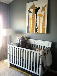 Giraffe wall art in a safari nursery - love this look!