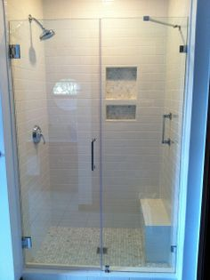 Georgie Emerson Vintage - our new shower with subway tiles and carrara marble hex tile floor