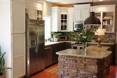 10 Kitchen Islands That We Wish Were in Our Kitchens -- dark lower cabinets, light upper cabinets