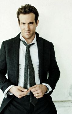 please ignore that it's Ryan Reynolds, see how the tie is thrown off? and the shirt fits, it's snug