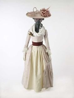 1780-1790This dress is made of white cotton woven with pairs of very fine red silk stripes. The cotton is quite coarse and probably would have been p...