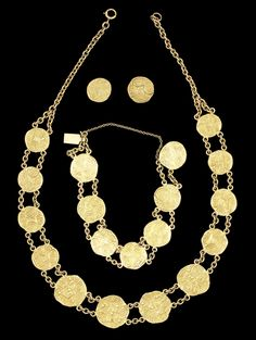A gold coin Necklace, Bracelet and Earrings Set South India, 13th Century and later the necklace composed of eight small six-chuckram and four larger twelve-chuckram Telegu-Choda gold coins bearing punch-mark inscriptions on the obverse, the plain reverses with striations, on double gold chain; the bracelet similarly designed comprising seven six-chuckram coins, one serving as part of clasp with reinforced back; the earrings of single six-chuckram coins with post and screw to reverse