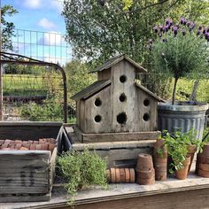 potting table and rustic birdhouse..