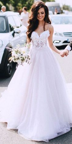 dbf883074  186.59  Delicate Tulle Spaghetti Straps Neckline A-line Wedding Dress With  Beaded Lace Appliques