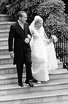 The first wedding to ever to take place in the White House Rose Garden was Tricia Nixon and Edward Cox's 1971 fete. The bride wore a classic lace design by Priscilla of Boston.