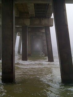 Fog under the pier. Gulf Shores, Alabama