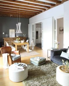 my style. Light wood floors, white walls, modern furniture and those really neat pocket doors.