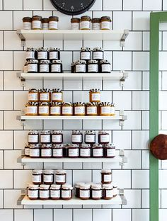 Jam jars displayed on EKBY JÄRPEN white wall shelves