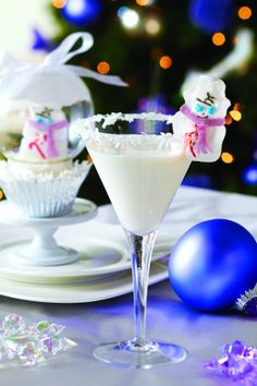 Get festive with a Snowy Treat, courtesy of @Sandra Lee Magazine. #SandraLee #holiday #entertaining #cocktail #recipe  Brush the rims of 4 martini glasses with light corn syrup & dip each into shredded coconut. Add 4 oz. @GODIVA® White Chocolate liqueur, 4 oz. Smirnoff® Iced Cake Flavored Vodka, and 8 oz. half & half. Shake with ice, divide into glasses, & garnish with a marshmallow Snowman. Makes 4 drinks.