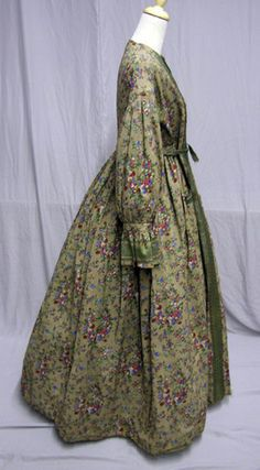 1860s printed wool wrapper. Cuff style is highly unusual -- original? Old eBay auction.
