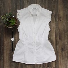 White Sleeveless Button-Down A casual top that's great for dressing up for work or down for a casual outfit. In like new condition. Adjustable tie in back / all buttons intact. No holes, stains or imperfections. Comes from a smoke free environment.  Bundles welcome Offers welcome through offer button. ❌NO trades, please. ⚡️Same/Next day shipping Allison Taylor Tops Button Down Shirts