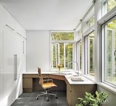 Plenty of storage and remarkable views to the wooded nature preserve, seen through casement windows that Martocchio used to replace double-hung windows, make the office one of homeowner Virginia Schwartz's favorite places in the new house.