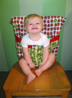 cover to create highchair...easy to slip on and great for traveling