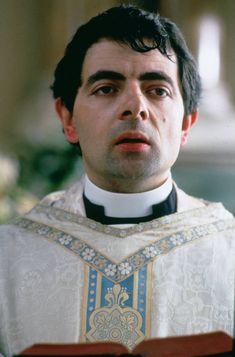 Rowan Atkinson as Father Gerald in Four weddings and a Funeral