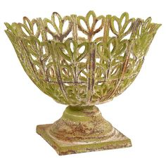 Add an artful touch to your entryway console table or living room mantel with this iron planter, showcasing an openwork design and a weathered green finish.