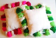 Almohadones con borlas