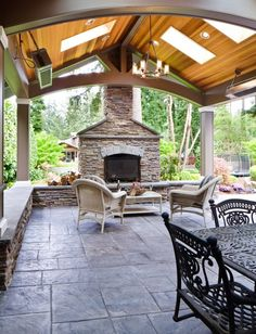 Patio with gable roof to match kitchen gable, w/beams & insulation under roof for summer heat and arbor extensions on each side, fireplace - use Spanish with log storage and seating on dining side