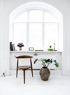 A wide, white window: a shrine for small objects.