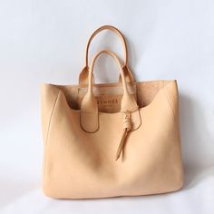 Would love a versatile neutral tote with some detail for summer into fall. This one is gorgeous!