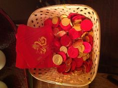 Chinese new year party favors - coins in red envelopes.