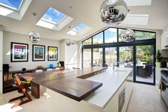 open plan kitchen living area in roof Kitchen Extension Lighting, Kitchen Diner Extension, Kitchen Extension Pitched Roof, Kitchen Lighting, Bungalow Extensions, House Extensions, Kitchen Extensions, Floor To Ceiling Windows, House Windows