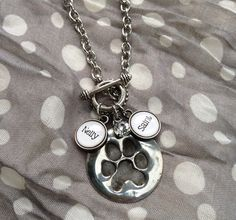 Paw print hand stamped molten metal pendant personalized  by kolejaxdesigns
