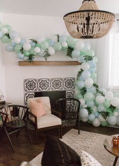easy inexpensive woodland baby shower idea with acorns, wood, blue, green and lanterns // baby boy baby shower ideas