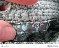 hand sew a fabric lining into a crochet bag