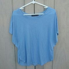 Loose Blue Flowing Top Light blue and gray stripes and is loosely fit.  Size small from The Limited. 60% rayon and 40% polyester. Has a tiny unnoticeable hole on arm seem. The Limited Tops