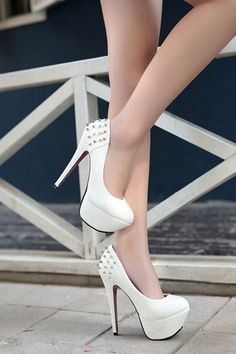 The pumps crafted in PU and rubber, featuring spike embellished heel part, low cut, high platform, round toe, high slim stiletto heels and skidproof rubber sole.