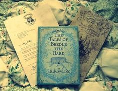 The Tales of Beedle the Bard, the marauders map and a hogwarts acceptance letter :) please someone buy  me all of these!!!! :D