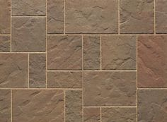 Blu aged patio pavers by Techo Bloc.  In 'Autumn Red'. This might be nice for the back patio.